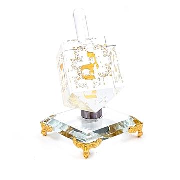 תמונה של סביבון קריסטל מהודר מסתובב בשילוב זהב